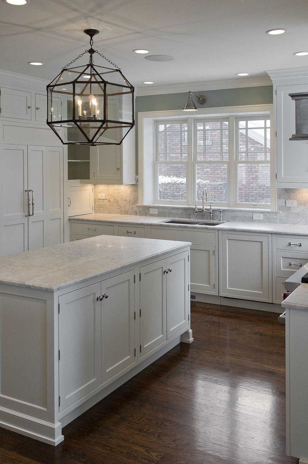 white kitchen cabinets with dark pulls white kitchen dark floors Dark floors