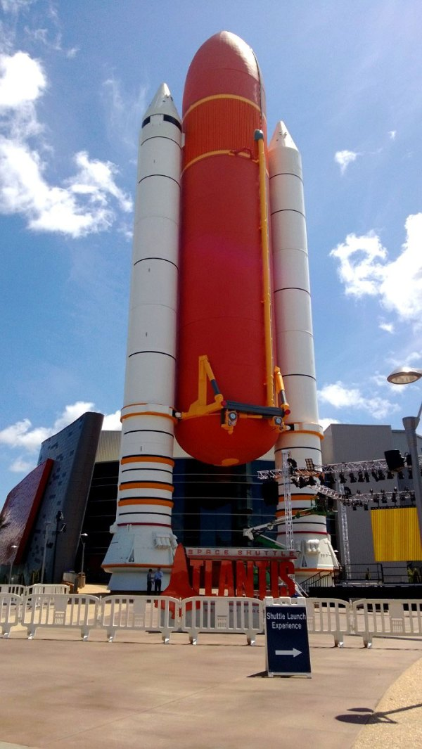 The entryway to the newly build Space Shuttle Atlantis exhibit, which presents a shuttle stack, or an external tank model as well as two model solid rocket boosters, which you walk underneath to enter the building.