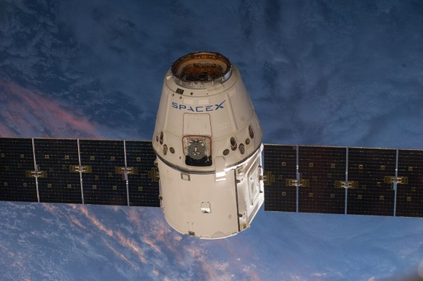 A photo of the arrival of the SpaceX Dragon (V1) at the International Space Station, photographed by the Expedition 39 crew members. The spacecraft was captured by the ISS and berthed, following its April 20 arrival.