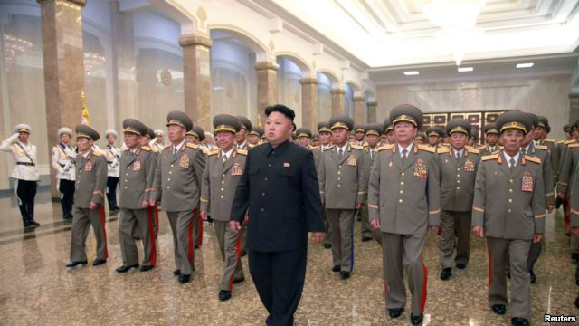 North Korean leader Kim Jong Un (C) visits the Kumsusan Palace of the Sun. KCNA, July 8, 2014.