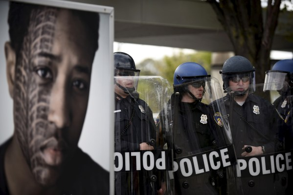 Police clashed with protesters near Mondawmin Mall after Freddie Gray's funeral. [Reuters]