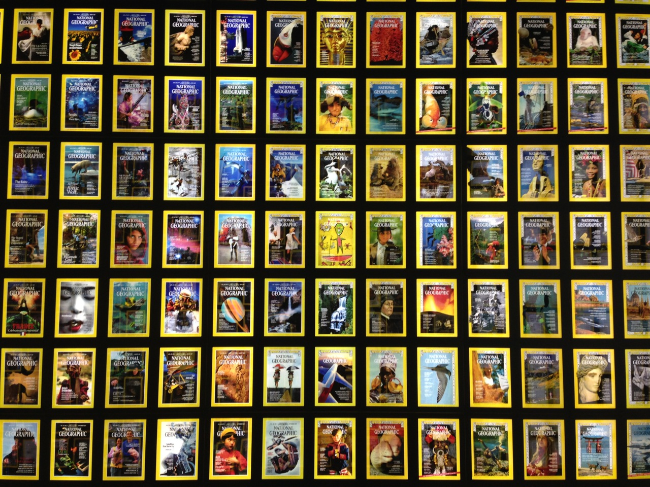 A wall of National Geographic magazine covers at the 125th Anniversary Exhibit in Washington, DC. (Photo by Andrew Evans, National Geographic Traveler)