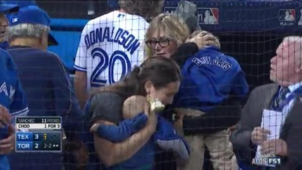 Beer from thrown can sprayed on this baby and mom at Toronto Blue Jays game.