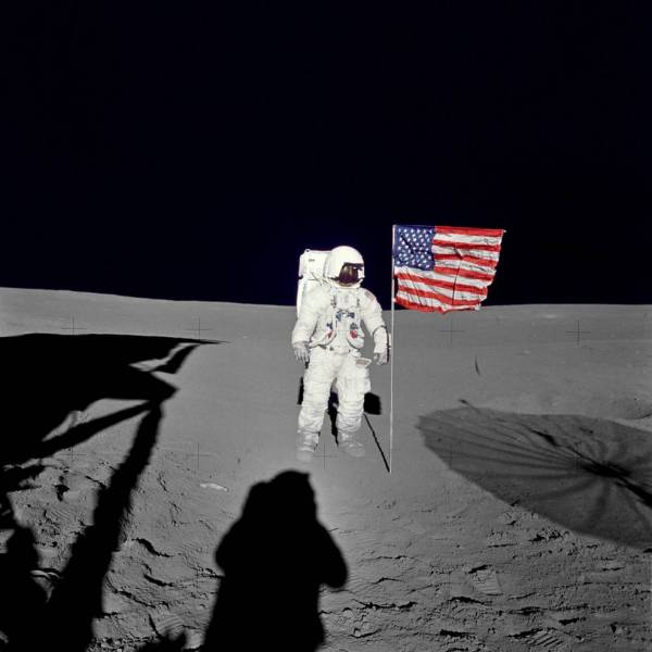Astronaut Edgar D. Mitchell, Apollo 14 lunar module pilot stands by the deployed U.S. flag on the lunar surface during the early moments of the mission's first spacewalk. Photo: NASA