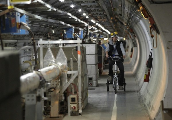 A technician cycles in the Large Hadron Collider (LHC) at CERN. [Reuters]