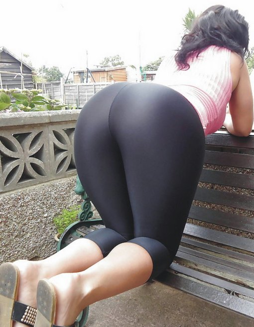 Women in yoga pants bending