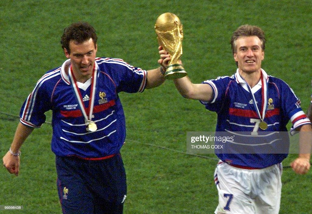 Didier Deschamps Pictures and Photos   Getty Images French captain Didier Deschamps and Laurent Blanc hold the FIFA trophy  after the 1998 Soccer World