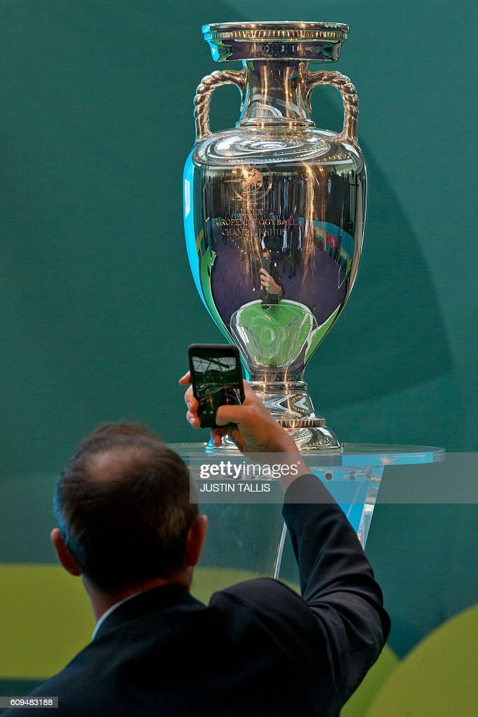 UEFA EURO 2020 Launch Event Photos and Images   Getty Images A guest takes a photograph of the UEFA European Championship football  competition trophy at a launch