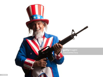 Man In Uncle Sams Costume With Gun Studio Shot Stock Photo | Getty Images
