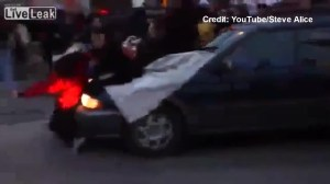 Car barrels through group of protesters at Ferguson demonstration
