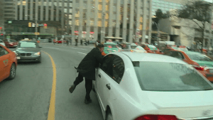 Taxi driver dragged by UberX car during protest in Toronto