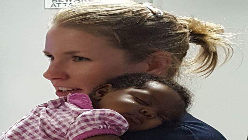 Police officer comforts 1-month-old after parents overdose