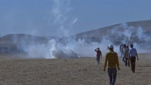 Tear gas fired as relatives of fleeing Syrians get too close to border