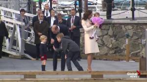 Boy gives flowers to Princess Charlotte, but gets denied on high five from Prince George