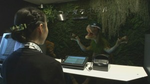 Robotic dinosaur receptionists are partial of a staff during Tokyo drudge hotel