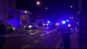 Police cordon off area where a vehicle hit several pedestrians in London, England