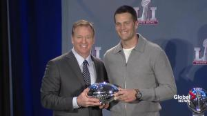 Roger Goodell presents Tom Brady with his Super Bowl MVP trophy