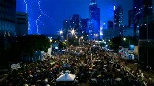 Peaceful protests continue in Hong Kong despite bad weather