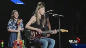 Edmonton area girl plays on stage during Keith Urban concert