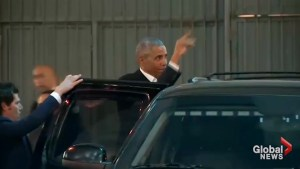 Obama greeted with cheers as he leaves New York theater with daughter