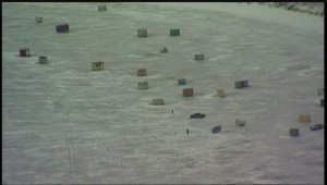 Aerial views of ice shacks still out on the ice of the Red River near Lockport