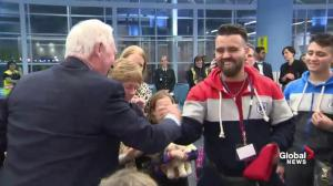 Gov. Gen. David Johnston greets Syrian refugees – says expect snow soon
