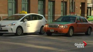 Taxi drivers and Uber drivers clash at city hall