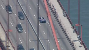 RAW: Indy car motorcade pays tribute to driver Justin Wilson on Golden Gate Bridge