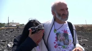 Family of passenger on downed flight MH17 visit crash site