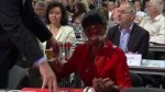 German politician gets slapped with cake in face by protester
