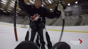 Brendan Parker tries sledge hockey
