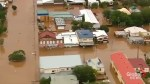 Two dead, tens of thousands stranded by Australia floods