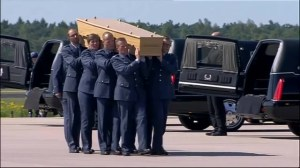 Somber ceremony for arrival for crash victims' bodies in Netherlands