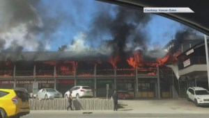 Fire at southwest Calgary strip mall shuts down Macleod Trail in both directions