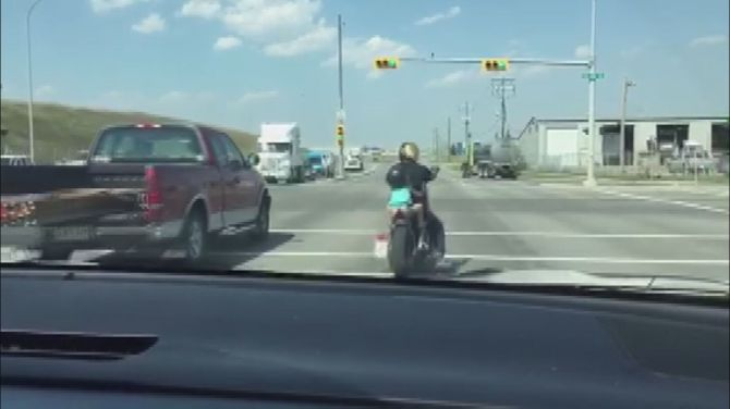 Raw video of a small child riding a motorcycle in Calgary