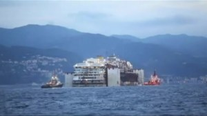 Raw video: Costa Concordia towed into Genoa