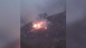 Amateur video shows plane crash site in Pakistan