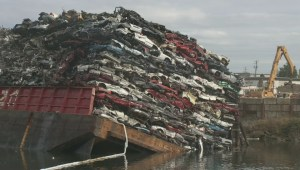 Barge carrying scrap cars tips in Victoria's Gorge waterway