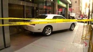 2 people taken to hospital after car crashes into sidewalk on Yonge Street