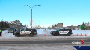 Edmonton police say 2 men found dead in truck were shot to death
