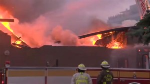 Massive fire engulfs electronics store on Toronto's Warden Avenue