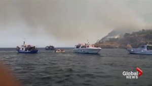 Tourists in Italy flee via boat as wildfires approach