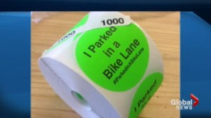 Sticker campaign shaming drivers who stop in bike lanes