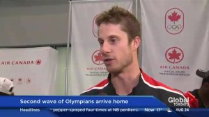 Gold-medal winner Derek Drouin arrives home from Rio
