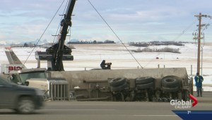 Driver charged for rolled over tanker on QEII Highway
