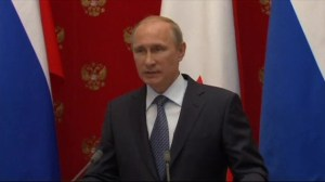 Putin says Russia withdrawing troops from Ukraine border