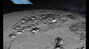 Animated flyover of Pluto's icy mountains and plains