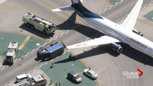 6 injured as plane landing at LAX clips utility truck