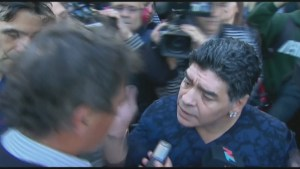 Soccer legend Diego Maradona slaps reporter on camera