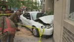 RAW: Car drives into building at Bay and College